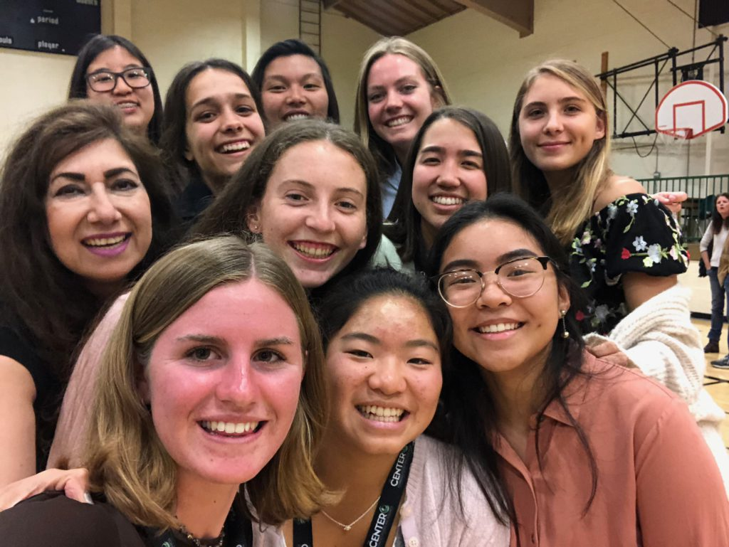 Educator Nikki Malhotra poses for a group photo with ten female students at Thousand Oaks High School.